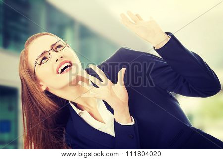 Beautiful caucasian woman is crouching.