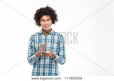 Portrait of a happy afro american man clapping hands isolated on a white background