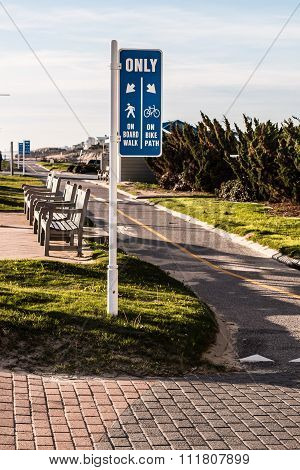Virginia Beach oceanfront boardwalk bike path with benches.