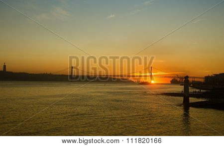 View of The 25 de Abril Bridge in Lisbon, Portugal during sunset