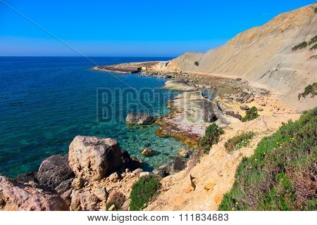 rough and rocky coastline of the island of malta , europe