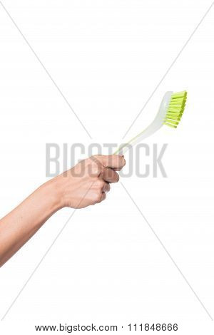 Brush In Hand On Isloated White Background