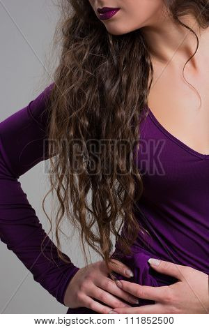 Seductive decollete concept. Profile portrait of beautiful young woman. Perfect natural make-up.
