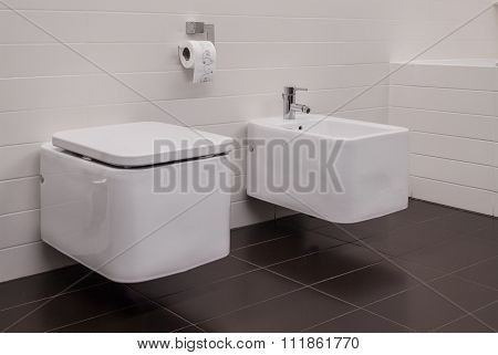 Toilet And Bidet In Bathroom