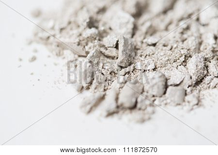 cosmetics, makeup and beauty concept - close up of loose eyeshadow or make-up powder pigment