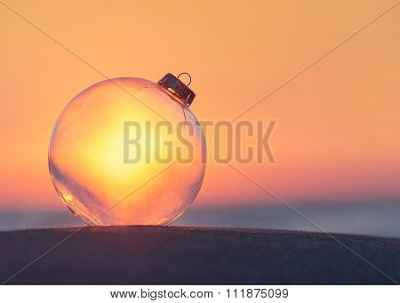 Christmas-tree Transparent Decoration Glass Ball At Sunset Ocean Beach