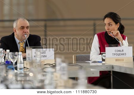 ST. PETERSBURG, RUSSIA - DECEMBER 13, 2015: Art historian Mikhail Mindlin and art producer Sofia Trotsenko at the round table discussion during 4th St. Petersburg International Cultural Forum