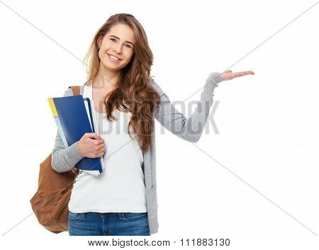 Portrait Of Happy Student Showing Something Isolated On White Background.
