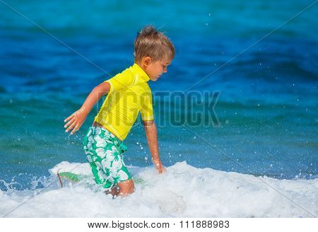 Cute boy surfing