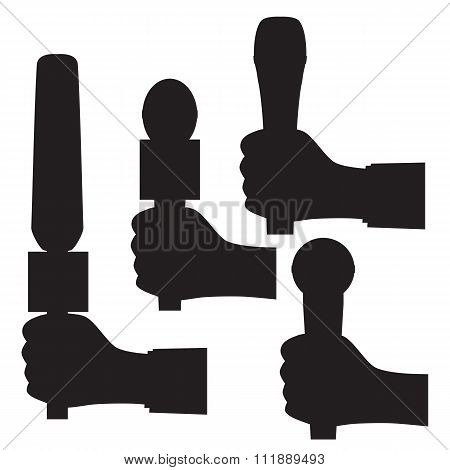 Black Silhouette Of A Hand With A Microphone.