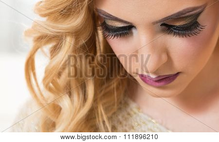 Beauty face makeup. Eyelashes extensions. Perfect Make-up closeup. Foundation. Cosmetic Eyeshadows, eyebrows.