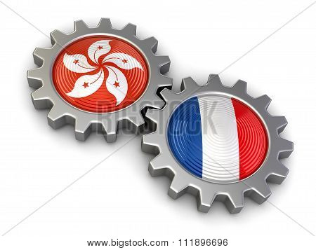 Hong Kong and French flags on a gears. Image with clipping path