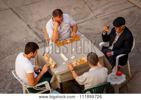 Men Playing Okey
