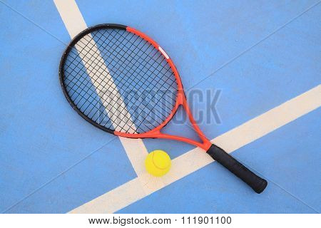 The image of tennis ball and tennis racket