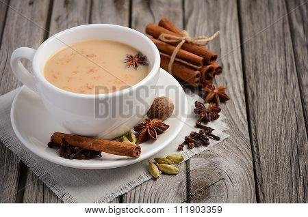 Indian masala chai tea. Spiced tea with milk.