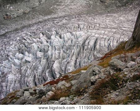 Crevassed Glacier Under The Rock