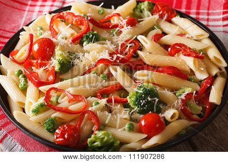 Pasta Primavera With Vegetables Close-up On A Plate. Horizontal