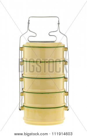 Vintage metal food carrier, known as Tiffin carrier, in yellow and green color isolated on white background