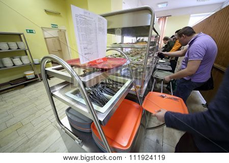 RUSSIA, MOSCOW - 18 MAY, 2015: People are taking from the shelves some food in refectory.