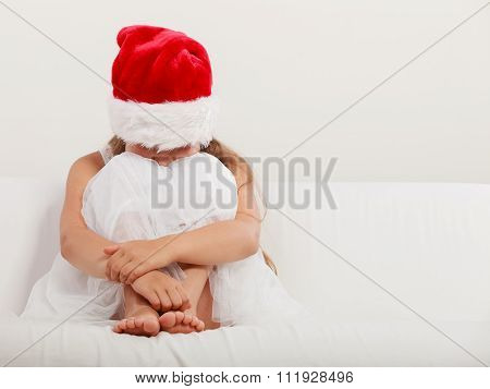 Lonely Little Girl Kid In Santa Hat. Christmas.