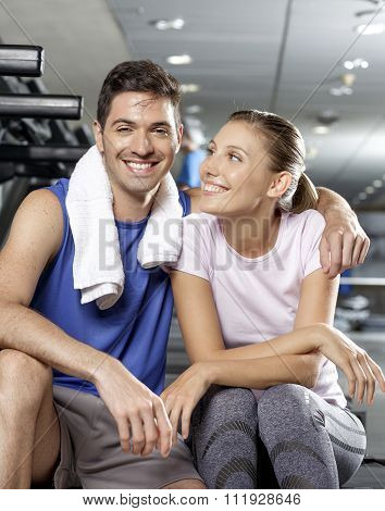 Man Kissing Girlfriend At The Gym