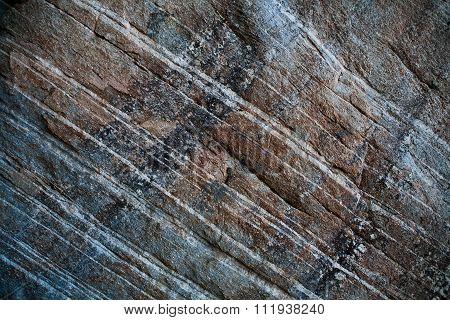 brown black white strips of a rock