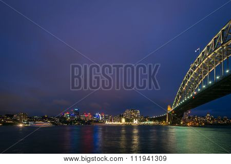 The View Of Luna Park And Sydney Harbour Bridge On A Clear Night