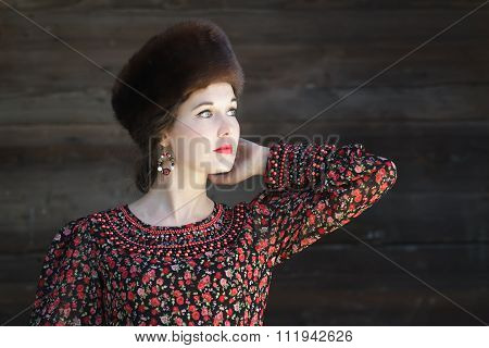 Three-quarter view portrait of looking away Russian beauty girl with outstretched elbow