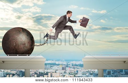 Image of young man jumping over gap