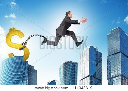 Man jumping over gap with gold dollar ballast