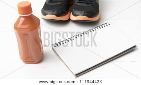 Running Shoes,orange Juice And Notepad