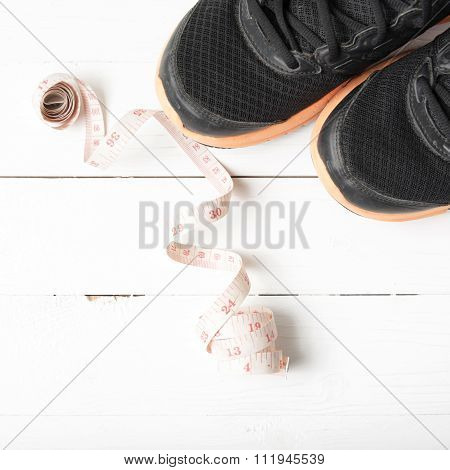 Running Shoes And Measuring Tape