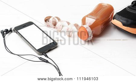 Running Shoes,orange Juice,measuring Tape And Phone