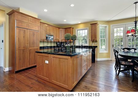Kitchen with wood cabinetry and granite counter