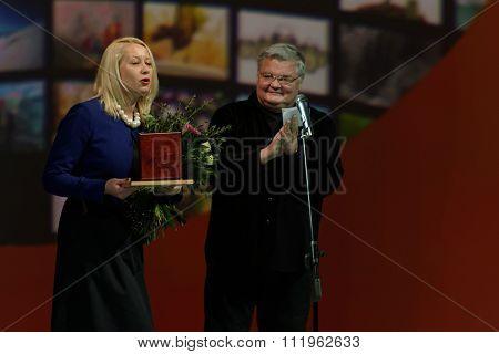 ST. PETERSBURG, RUSSIA - DECEMBER 16, 2015: Artistic Director of Petersburg-concert Sergey Stadler (center) during the closing ceremony of 4th St. Petersburg International Cultural Forum