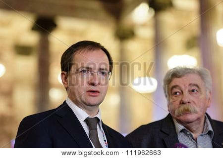 ST. PETERSBURG, RUSSIA - DECEMBER 14, 2015: Russian Minister of Culture Vladimir Medinsky (center) and Director of Russian Museum of Ethnography Vladimir Grusman during St. Petersburg Cultural Forum