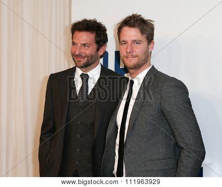 NEW YORK-DEC 13: Actors Bradley Cooper (L) and Jake McDorman attend the