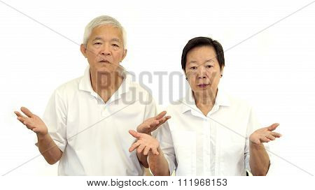Asian Senior Couple Do Not Like A Deal. Upset And Do Not Satisfy