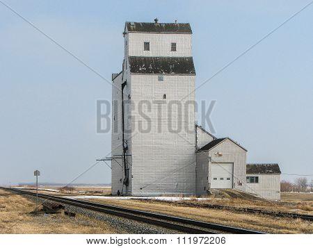 Grain Elevator By Track In Prairie