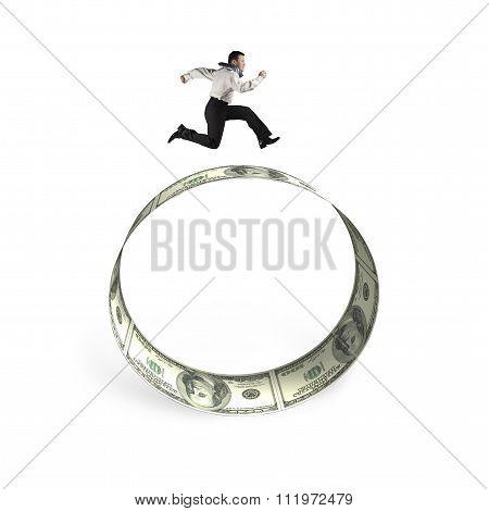 Man Running On Circle Of Dollar Bills
