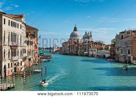 VENICE, ITALY - 17 OCTOBER 2015: Grand Canal and Basilica Santa Maria della Salute in Venice, Italy, as seen from the Ponte dell'accademia bridge. Venice, Italy on 17 October 2015.