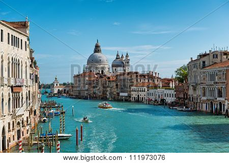 VENICE, ITALY - 17 OCTOBER 2015: Grand Canal and Basilica Santa Maria della Salute in Venice, Italy, as seen from the Ponte dell'accademia bridge. Venice, Italy on 17 October 2015.