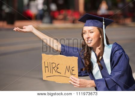 Graduate With Hire Me Sign