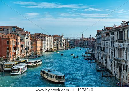VENICE, ITALY - 17 OCTOBER 2015: Vaporetti water bus traffic on the Grand Canal viewed from an elevated position overlooking the canal in a picturesque view. Venice, Italy on 17 October 2015.