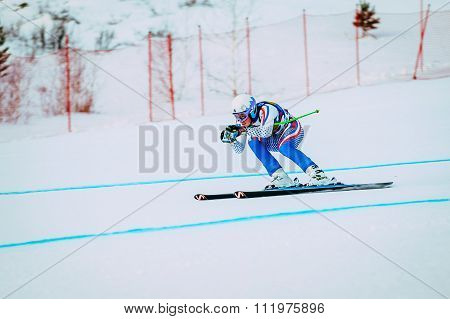 downhill young girl athlete skiing to competition Russian Cup in alpine skiing