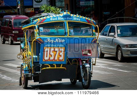 Very Bright and Colorful Tricycle of A Filipino