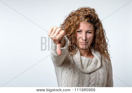 Young Woman Giving A Thumb Down Gesture