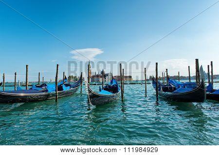 Moored gondolas in the Giudecca Canal, Venice, Italy with a view across the water to San Giorgio Maggiore