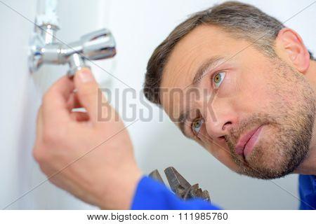 Plumbers inspecting a leak