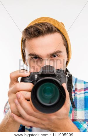 Young Photographer With Hat Taking A Photo